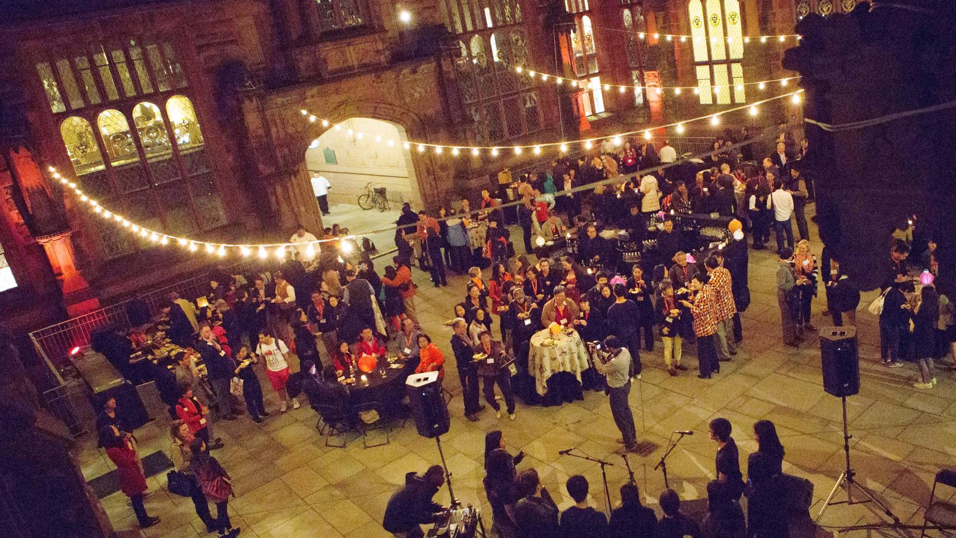 alumni gathered in courtyard at night