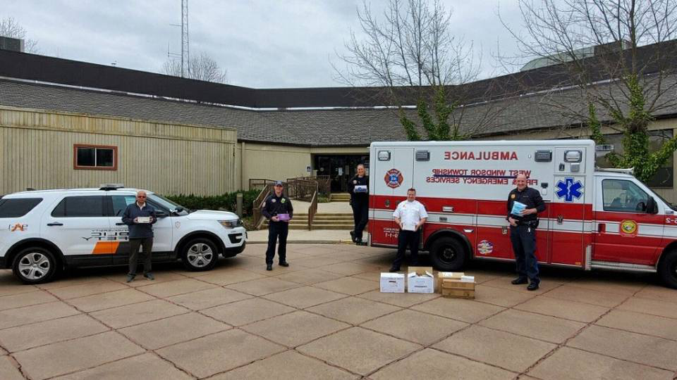 Staff pose with emergency vehicles 和 supplies in West Windsor