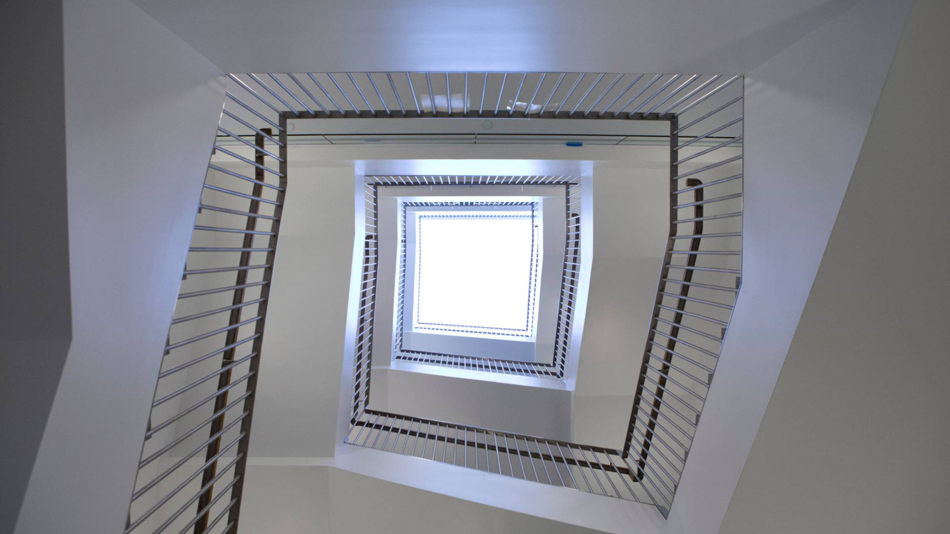 Looking up through a stairwell into a skylight