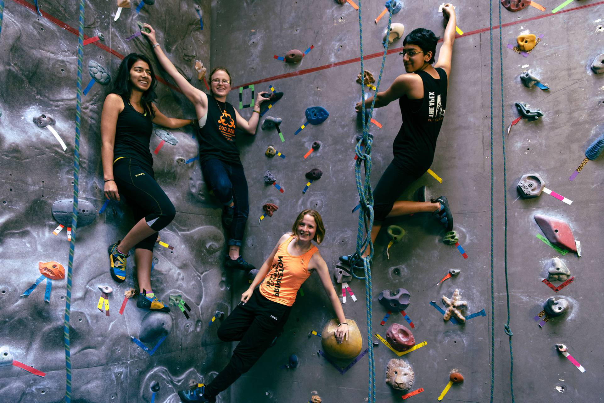 students on a rock climbing wall