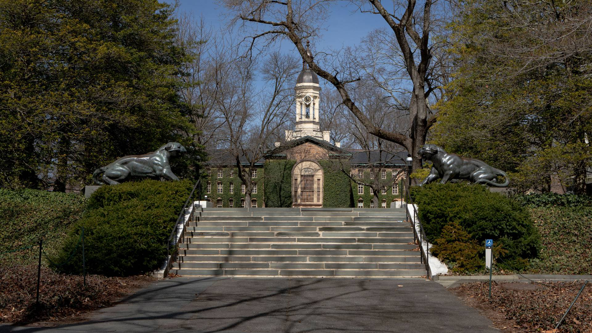 Nassau Hall with tigers in early spring