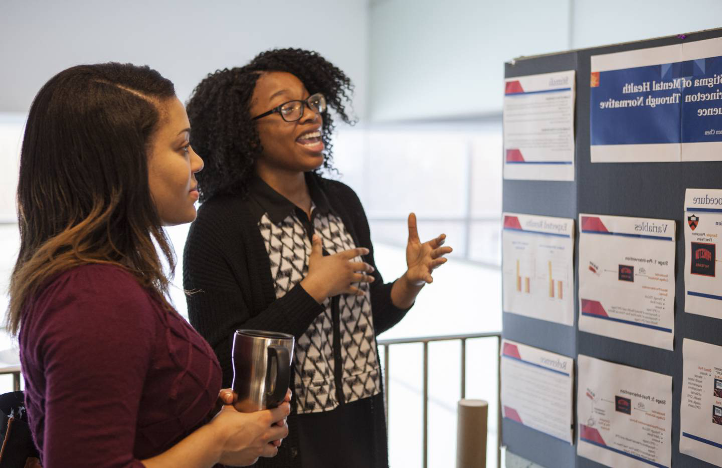 A student presents her findings at the 2017 CBLI Poster Fair